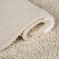 Beige rug with large white dots
