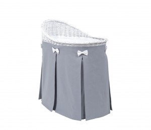 Mobile wicker bed with dark grey skirt