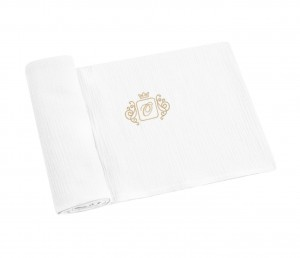 Swaddling blankets with gold emblem