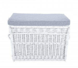 White wicker trunk with grey pillow