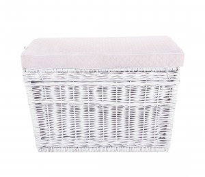 White wicker trunk with pink pillow