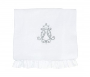 Blanket with white flounce and silver emblem