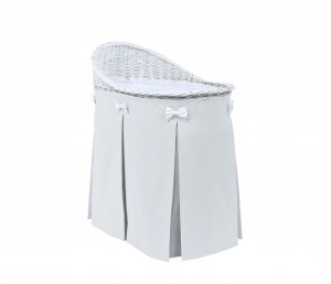 Mobile wicker bed with velvet light grey skirt