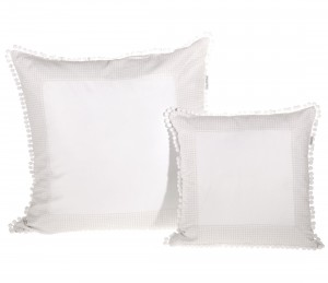 Small beige pillow with bobbles