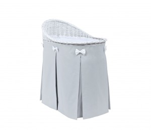 Mobile wicker bed with light grey skirt