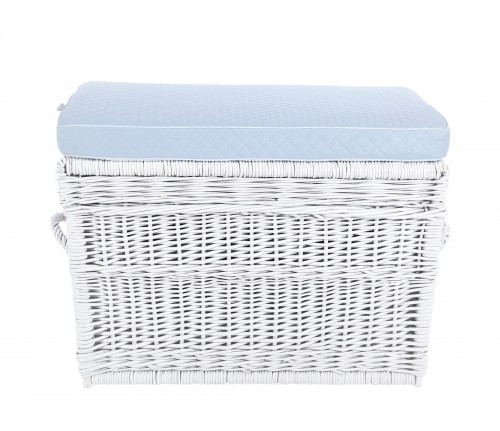 White wicker trunk with blue pillow