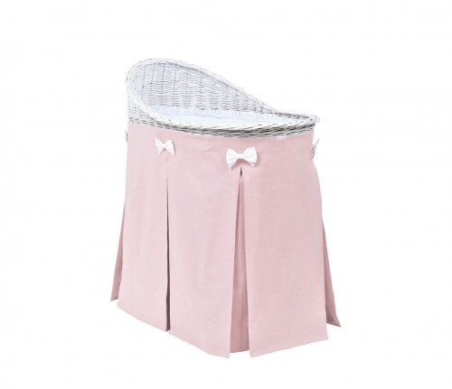 Mobile wicker bed with pink skirt